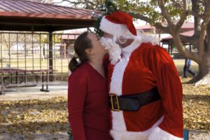I believe in santa clause kissing